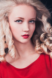Beautiful young blonde woman in red