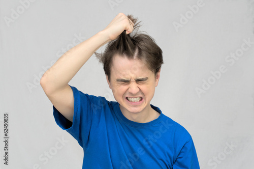 Man tearing his hair