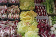 Red radicchio and chicory salad and other fruits for sale at the