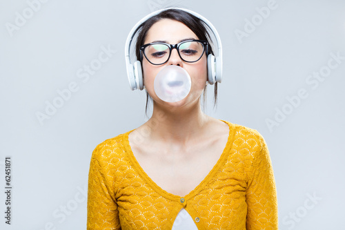 Beautiful brunette woman listening to music
