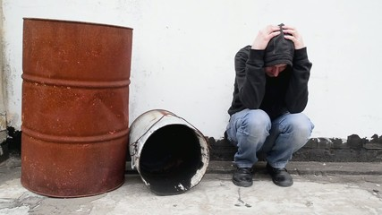 Man with problems alone on the street. Drug addiction concept.