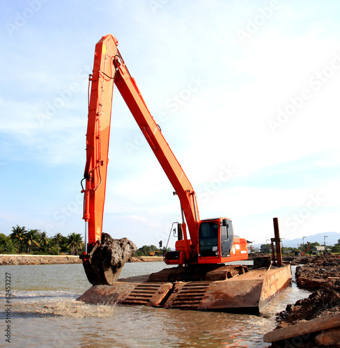 Loaders working in the middle of the river.