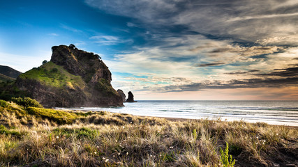 Beatiful sunset on Piha beach, New Zealand