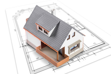 House standing on plan or blueprints