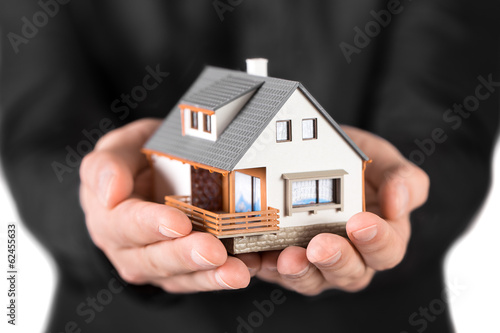 House in man's hands