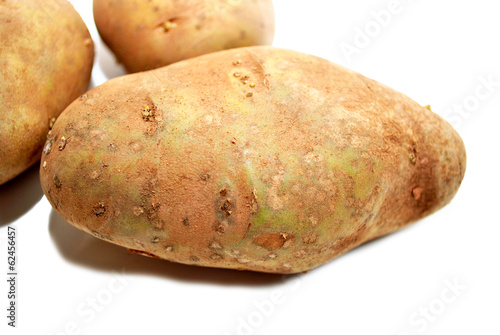 Close-Up of a Raw Potato Over White
