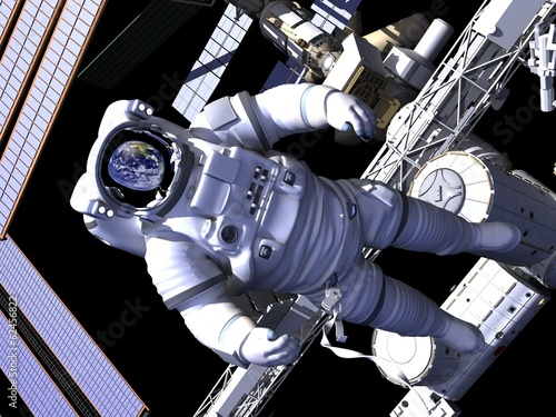 The astronaut and flying modern satellite in outer space