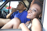 Black couple sit and relax in car