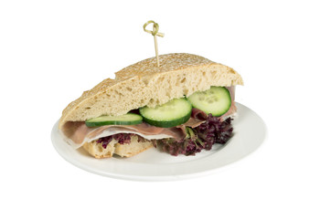 Tuscan chicken baguette on a white background.