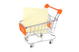 Blank paper sheet in shopping cart isolated on white