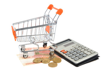 Shopping cart, money and calculator isolated on white