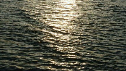 sunlight shining on sea water