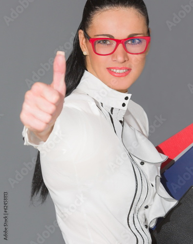 happy smiling woman shows a finger up