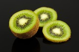 Kiwi Fruit Slices on Black Background