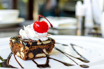 Chocolate and macadamia brownie with cherry
