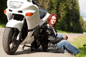 woman near a motorcycle