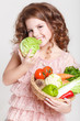 Little child with healthy vegetable, organic food