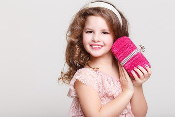 Glamour little girl in fashion dress, trendy kid