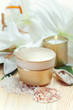Moisturizing face cream with candle and white lilies