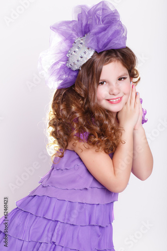 Fashion little girl in fashion violet dress, trendy kid