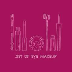 set of eye makeup on a burgundy background