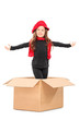 Playful girl standing in a box