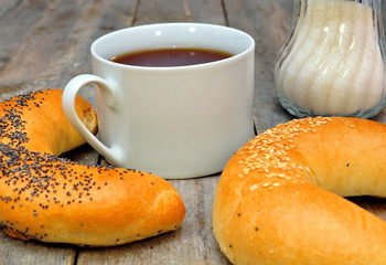 bagel with poppy seeds and a cup of tea