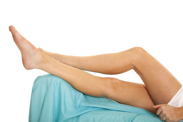 woman legs blue sheet lay bed
