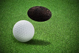 Decorative grass and golf ball with hole