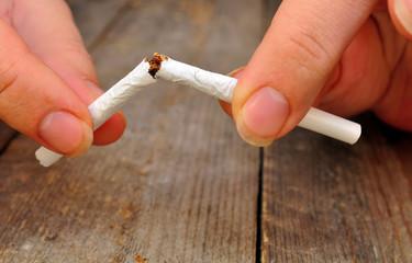 Female hands thin broken cigarette