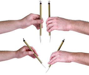 hands with Japanese calligraphic brush