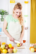 Young woman slicing apple