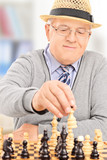 Senior gentleman playing chess at home