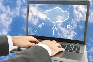 Businessman using cloud computing