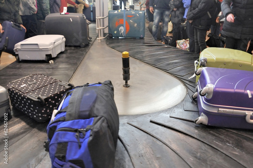 Luggages moving on baggage belt