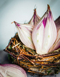 Halved red onions in a basket