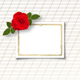 Bouquet of beautiful red roses with the invitation or congratula
