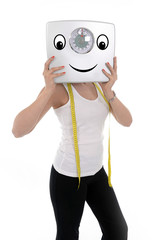 young sport woman holding scale happy face