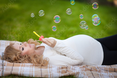 Beautiful pregnant woman in spring outdoor