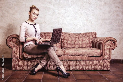 Business woman using computer. home technology. Vintage photo.