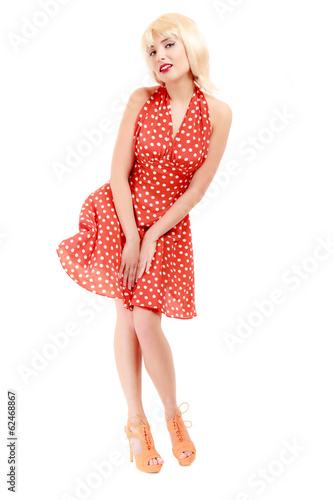 Full length pinup girl in blond wig retro red dress. Vintage.