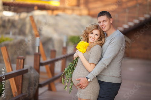 Pregnant woman and husband happy family pregnancy