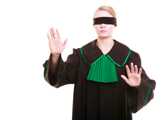 Lawyer in classic polish gown covering eyes with blindfold