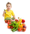 Funny kid boy eating vegetables. Healthy food concept.