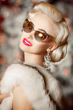 Vogue blonde woman with retro sunglasses and hairstyle, luxury