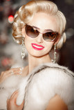 Beautiful woman with retro sunglasses and hairstyle luxury