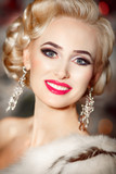 Beautiful blonde woman with retro makeup and hairstyle, luxury
