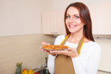 woman holding plate with healthy foods