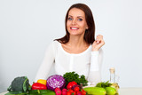 happy young woman with vegetables