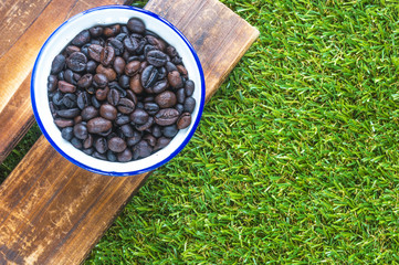 Coffee beans and platform with green background